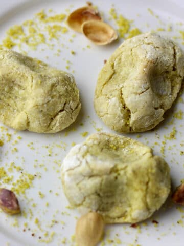 A plate with baked pistachio cookies.