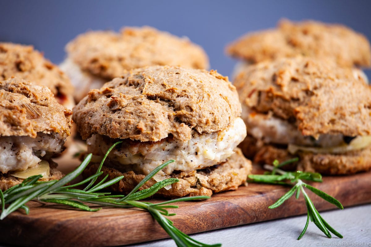 Close-up of Healthy Italian Seasoned Turkey Burgers on Biscuits