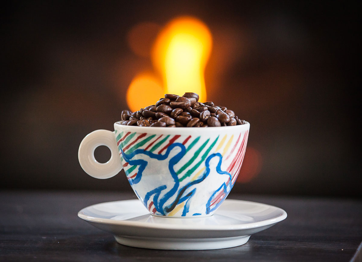 coffee cup and coffee beans in front of fire place