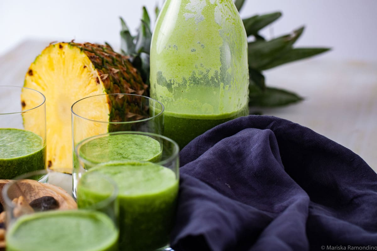 CREAMY PINEAPPLE SMOOTHIE INFUSED WITH GREEN JUICE & SEEDS AND HALF A PINEAPPLE