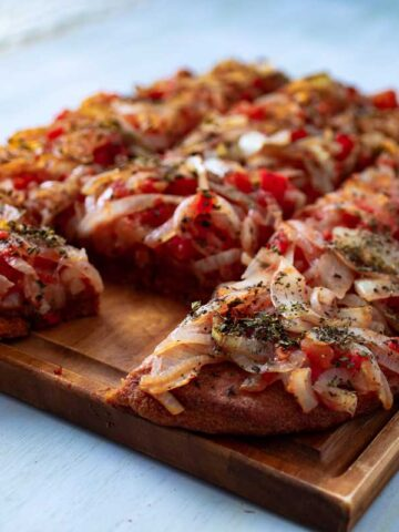 THICK-CRUST SICILIAN-STYLE PIZZA CUT INTO SQUARES