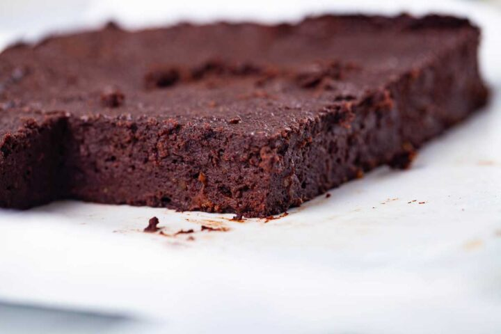 A closeup of squared cut chocolate brownies.