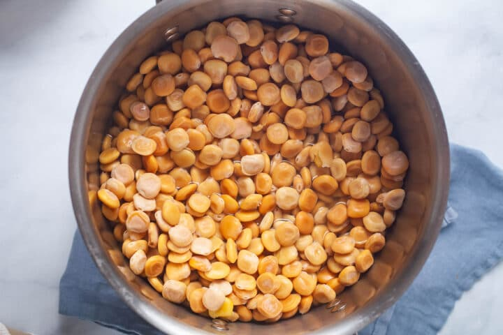 A large pot filled with cooked Lupini beans.