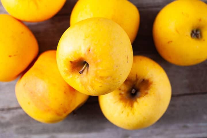 A close-up of golden apples.