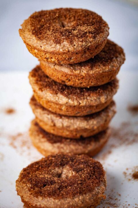 Cinnamon sugary topped doughnuts stacked on top of each other.