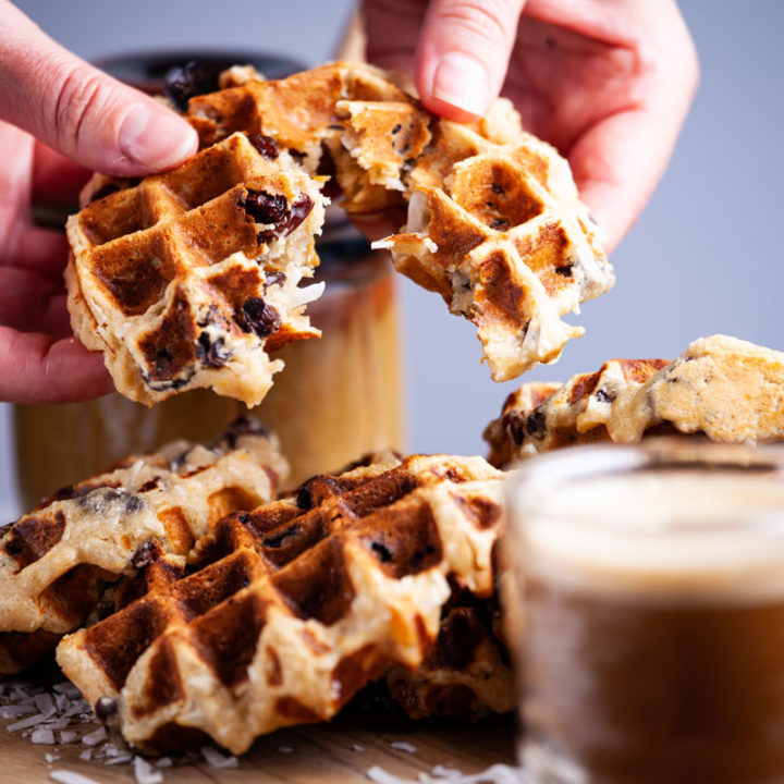 Gluten-free waffle showing delicious raisins and coconut shreds inside