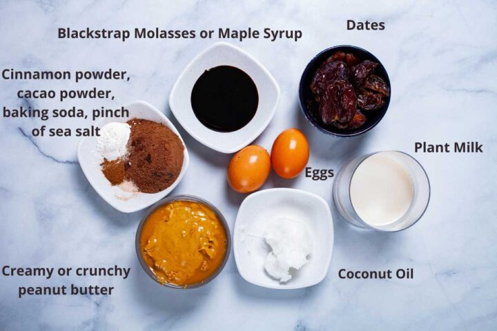 Ingredients to make flourless peanut butter cookies: blackstrap molasses or maple syrup, dates, plant milk, eggs, coconut oil, creamy or crunchy peanut butter, cinnamon powder, cacao powder, baking soda, pinch of sea salt.