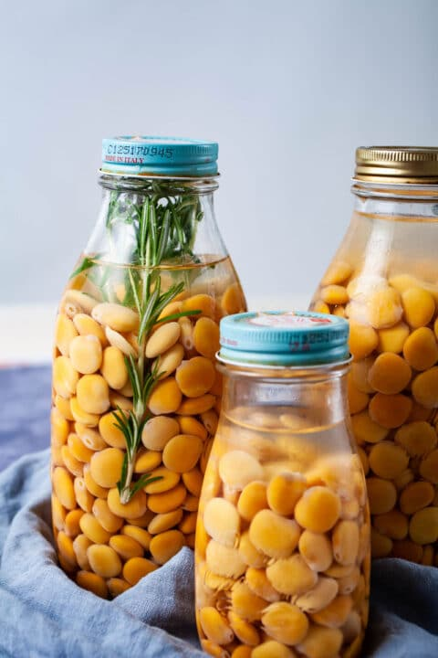 Lupini beans soaked in brine in mason jars with a lid.