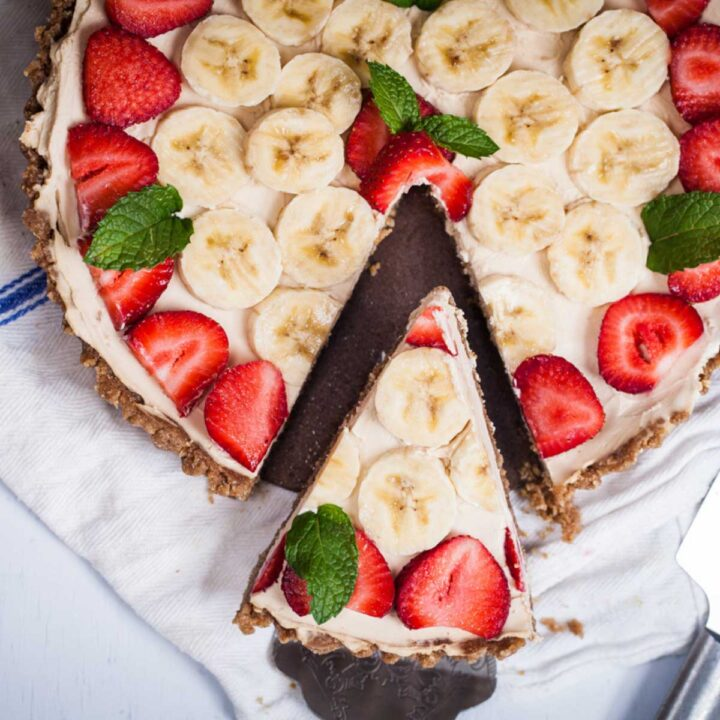 A slice cut and lifted from a round fruit tart.