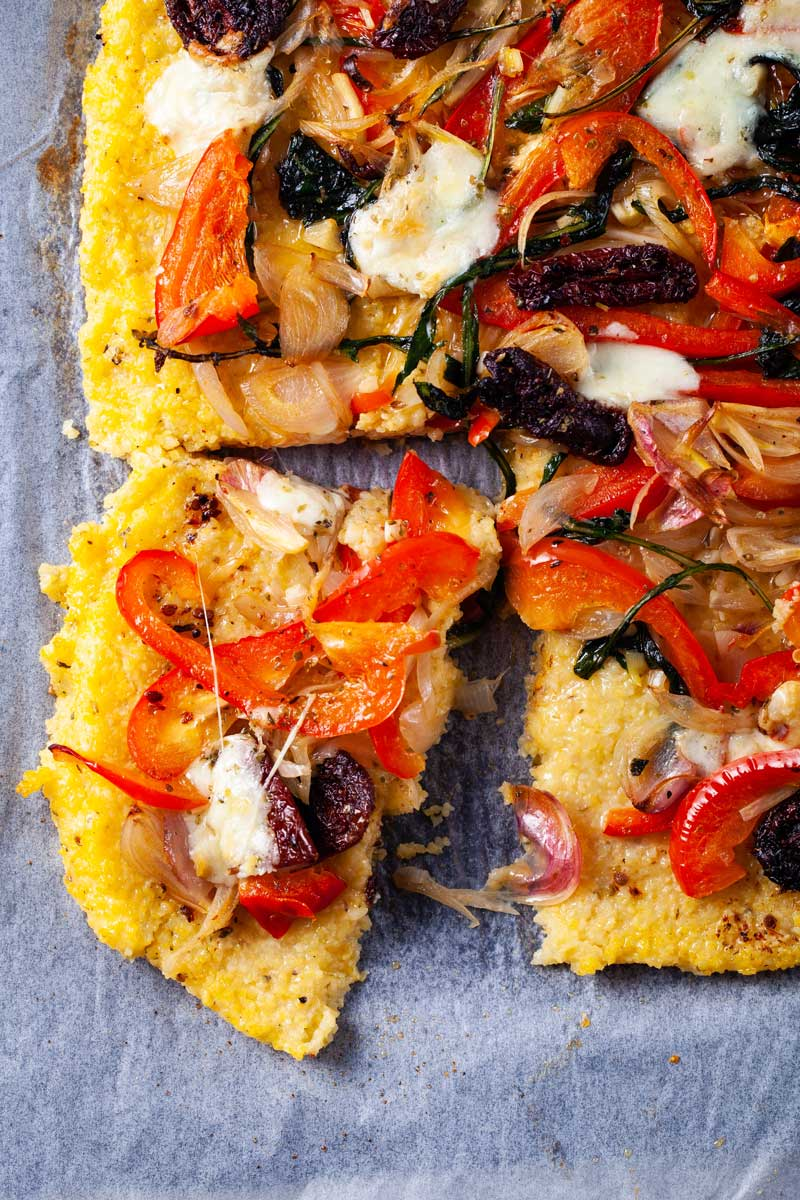 Savory gluten-free pizza with polenta crust and veggie toppings