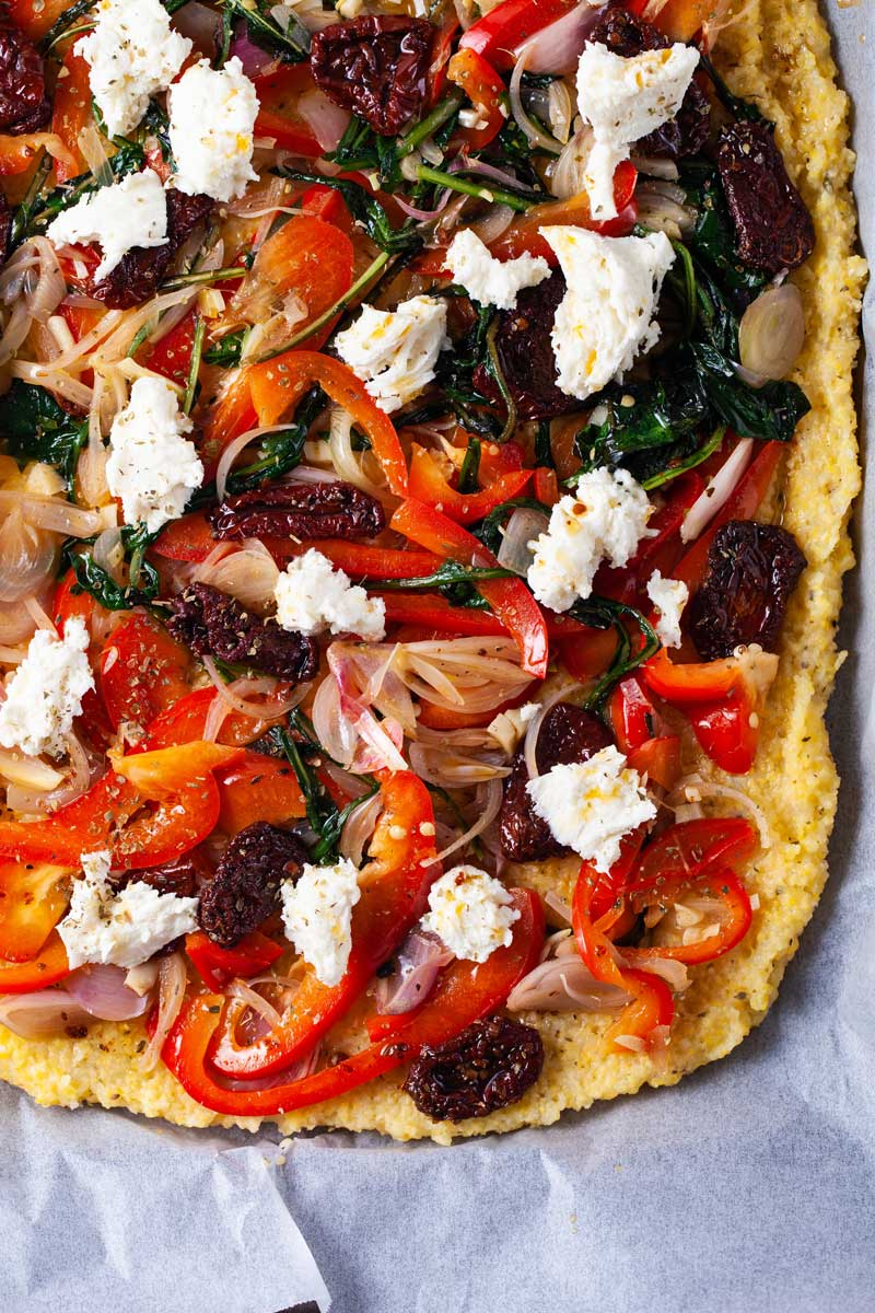 Savory gluten-free pizza with veggie toppings, and mozzarella.
