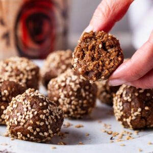 A bite out of a protein ball energy snack.