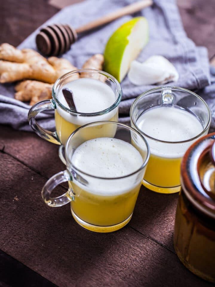Three homemade wellness shots displayed