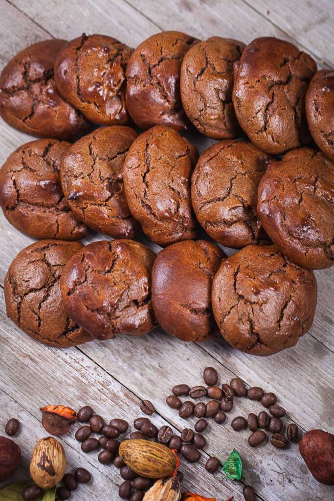 Soft brown cookies neatly laid out on a wooden board.